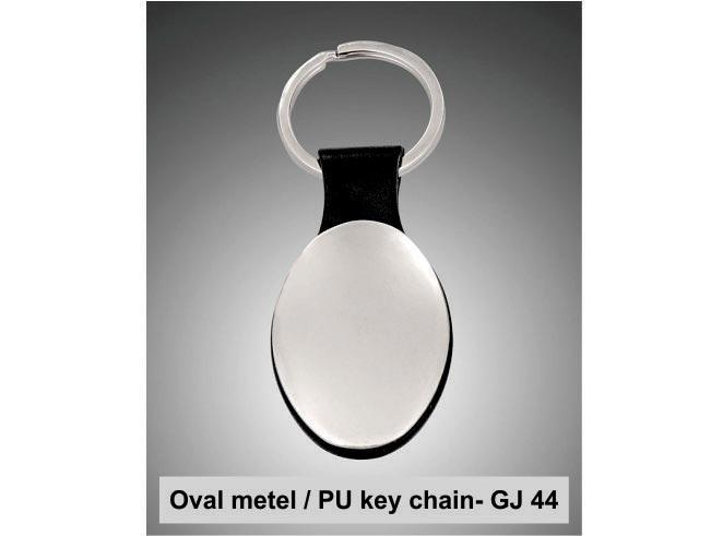 GJ44 - Oval metal / PU key chain